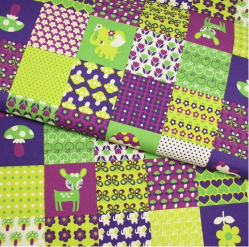 Cute little animals in squares in green and purple by Kokka